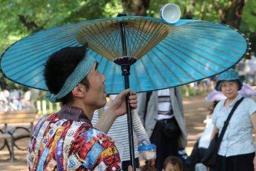 Spinning sake cup on a Japanese umbrella