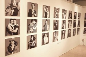 Wall full of black and white portraits