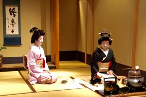 Geisha conduct a traditional tea ceremony during intermission