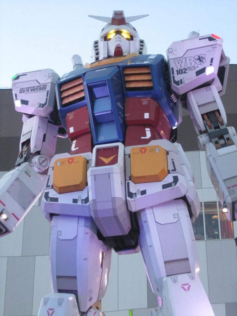 <p>Front of Gundam at dusk with lit up eyes</p>