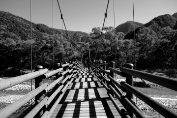 one of the many wooden bridges across the river