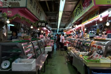 Rows of stores beckon on the first level of the Makishi Public Market