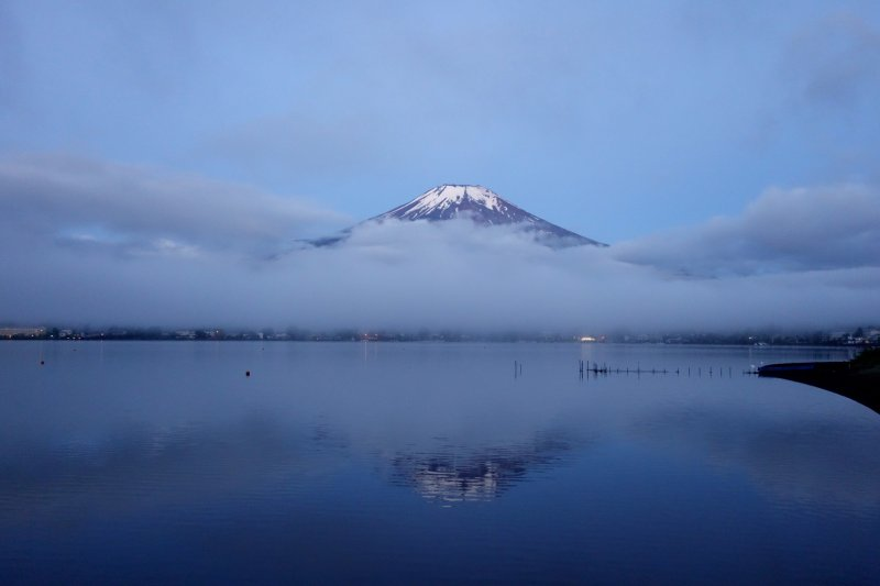 """It is still calm across the lake surface, perfect conditions for reflecting Mt. Fuji (known as """"Sakasa Fuji"""" or Upside-down Fuji)"""