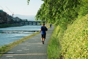 Man jogging along the riverbanks