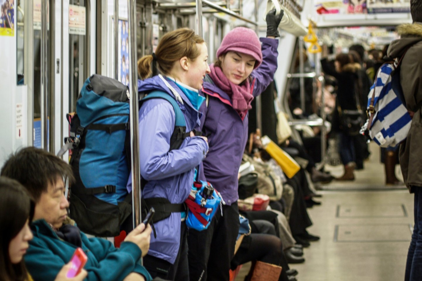 On the subway in Sapporo with hiking packs on