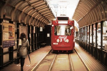 catching the street car in Susukino
