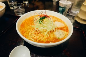 A large bowl of spicy ramen