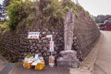 A 'people-less Vegetable Stand'. Because of its rural location any customer can buy something by simply leaving their money in a box. This trust based payment system is common in many rural parts of Japan but probably unheard of in many other countries!