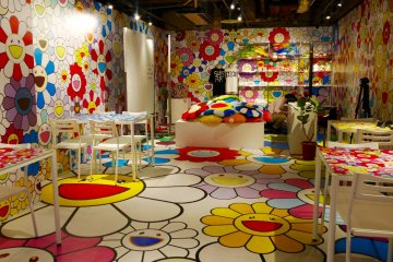 Zingaro Space, right around the corner from the cafe, is lined from top to bottom with Murakami's famous flowers