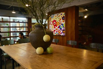 The cafe/bar is mixture between quirky, colorful art and modern, earthy furniture