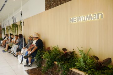 Shoppers rest to chat and admire the garden outside