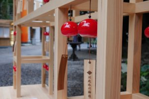 These red wind chimes make delicate sounds in the wind