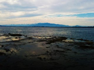 Rocky tide pools are visible along the beach.