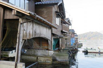 Many fisherman live in Ine Village in boathouses like these