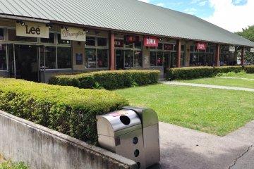 Stores around a grassy center