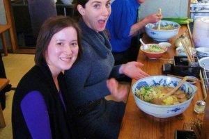 Three happy costumers enjoying the tokudai sized ramen. Delish!