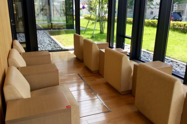 Relaxing couches facing manicured zen gardens