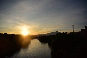 Sun setting over the Kitakami River