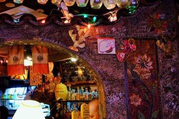 Multicoloured lights make the restaurant a surreal environment