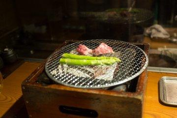 Pork and asparagus on a table top grill