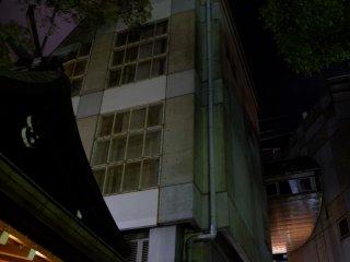Osaka's high rise modern buildings overlook the shrine