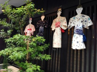 These kimono-clad figures were displayed on many of the stores