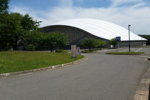 The Akita Sky Dome pops out of the greenery like a giant heap of unmelted snow, with a floor was upgraded in 2015 with new artificial turf after a period of dirt