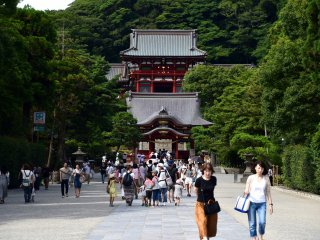 Pass the torii gate and you'll see the main hall beyond the Mai-den (dancing platform)