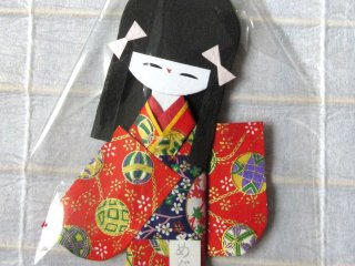 This paper doll from Matsumoto has a temari pattern on her kimono