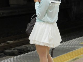 A girl engrossed into her phone