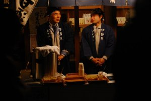 Clerks sell a sweet style of rice wine — called amazake — often served with ginger. The drink is a new year's speciality.