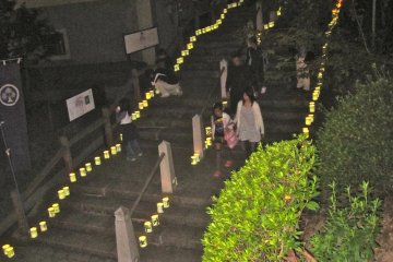 The stairs of the main entrance are lined with paper lanterns during the Koshiro Matsuri