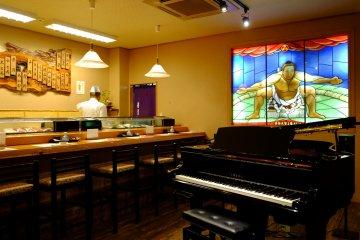 Grand piano and sushi bar