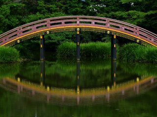Beautiful reflection of an arched bridge