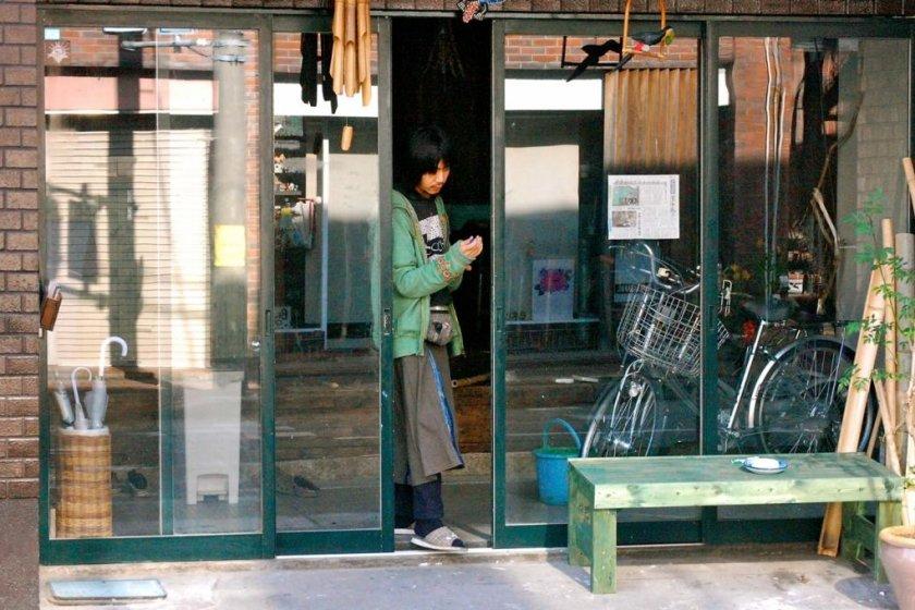 Owner Hiromichi Marui steps outside for a break.