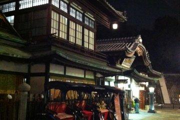 Dogo Onsen Honkan at night