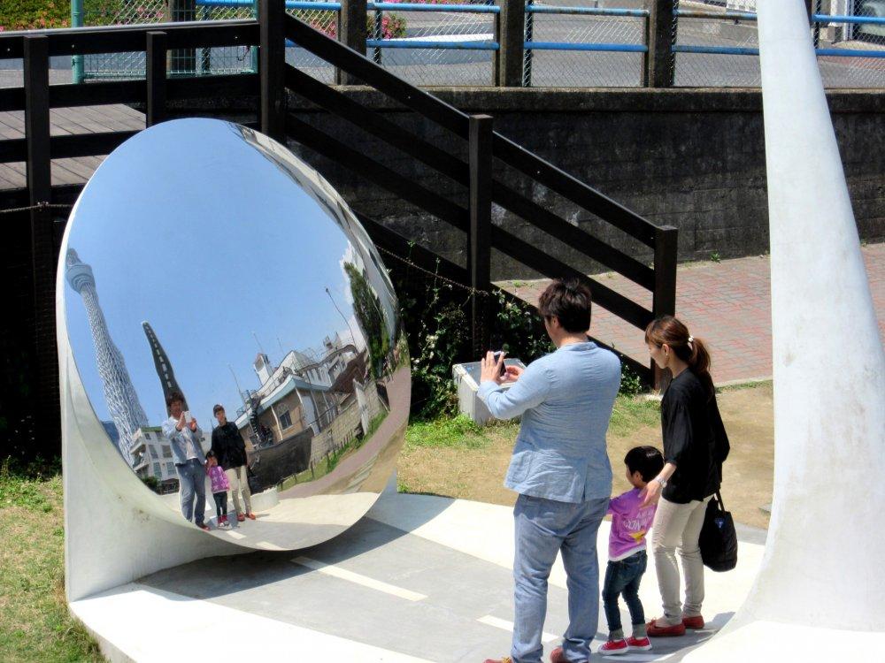 Family photo. Round mirror on the way to Sky Tree, Tokyo