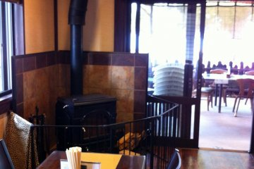 The inside seating with a wood-burning stove