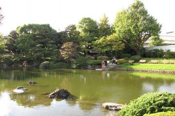 Traditional dress alongside the pond