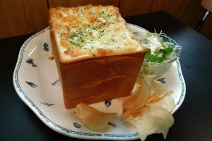 Seafood gratin served in a bread case is the star of the menu