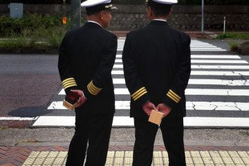 Naval officers in Kure with sake cups