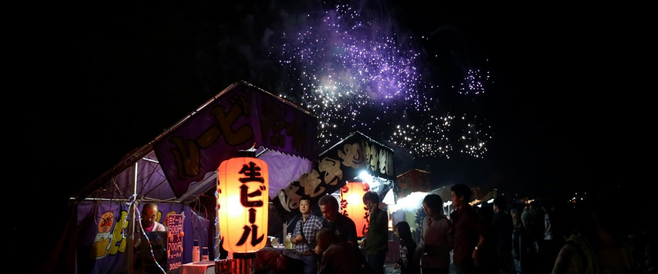 Magical display of fireworks as a backdrop for the many festive food stalls