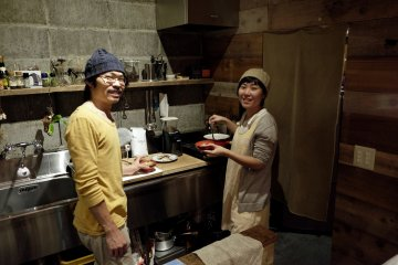 Owners, Mari and Takashi, preparing dinner for guests and friends