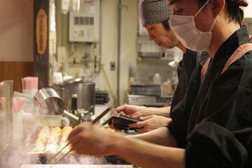Half the fun is watching the chefs flip the delicate takoyaki with chopsticks from a special pan.