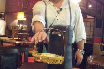 Manager Hitokoto-san explains the sakura tofu