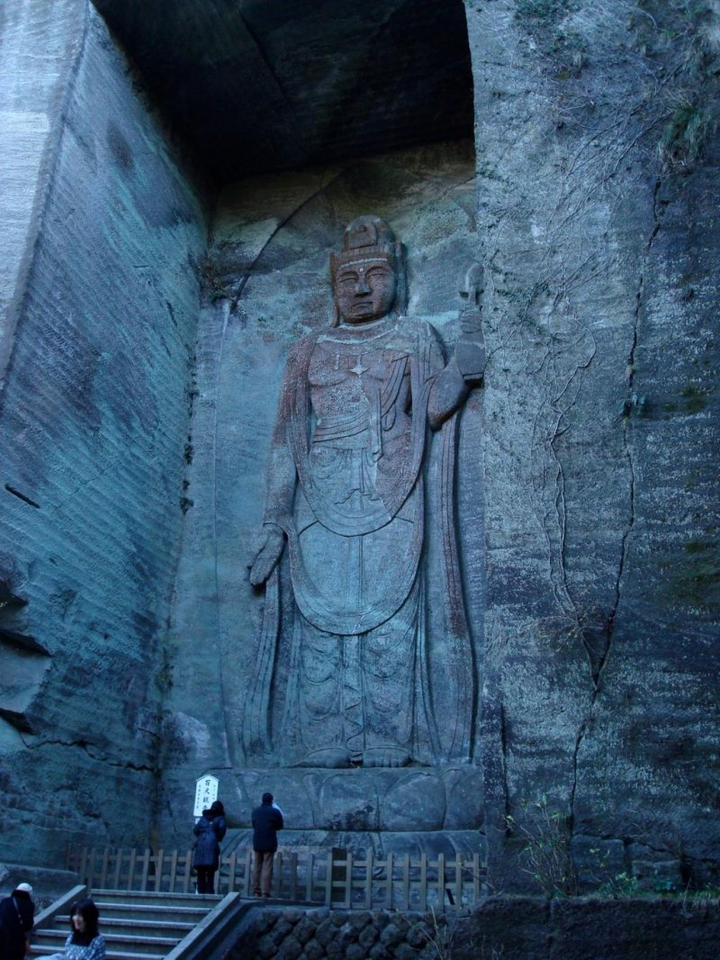 A tall relief image of Kannon carved into the wall