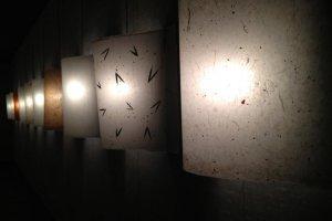 Hallway of wall mounted washi lamps