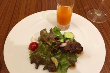 A freshly squeezed juice and salad