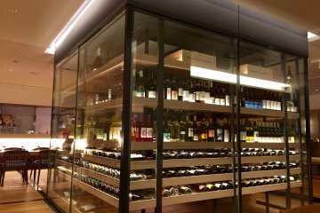A modern-looking wine cellar in the middle of the restaurant