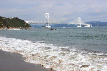 The Naruto Strait and the Onaruto Bridge from the shore. You can see the Aqua Eddy under the bridge.